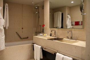 Two sinks and a large combined shower and tub