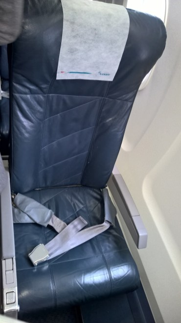 A single seat on the lef side of the airplane