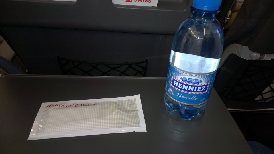 A bottle of water and a refreshing tissue await you when boarding