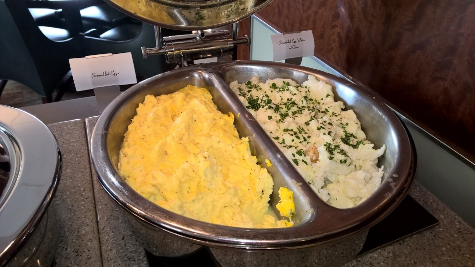 Different kinds of scrambled egg on the buffet