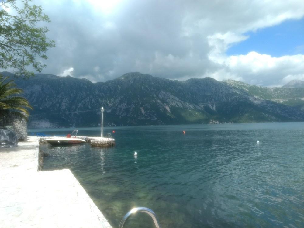 Perast town beach boat point, Bay of Kotor, Montenegro, Europe