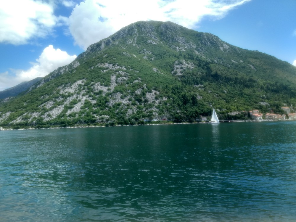 Boat ride from Perast town to 'Our Lady of the Rocks' Island, Montenegro, Europe