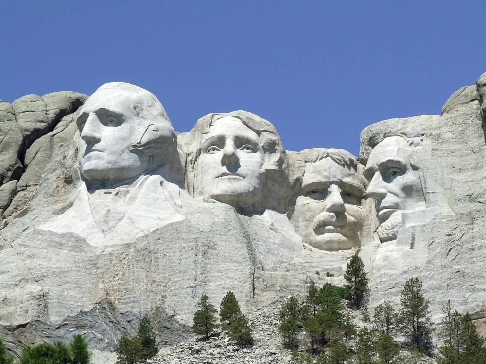 Best things to do in the Black Hills with Kids, featured by top US family travel blog, Travel with a Plan: image of Mount Rushmore, presidents