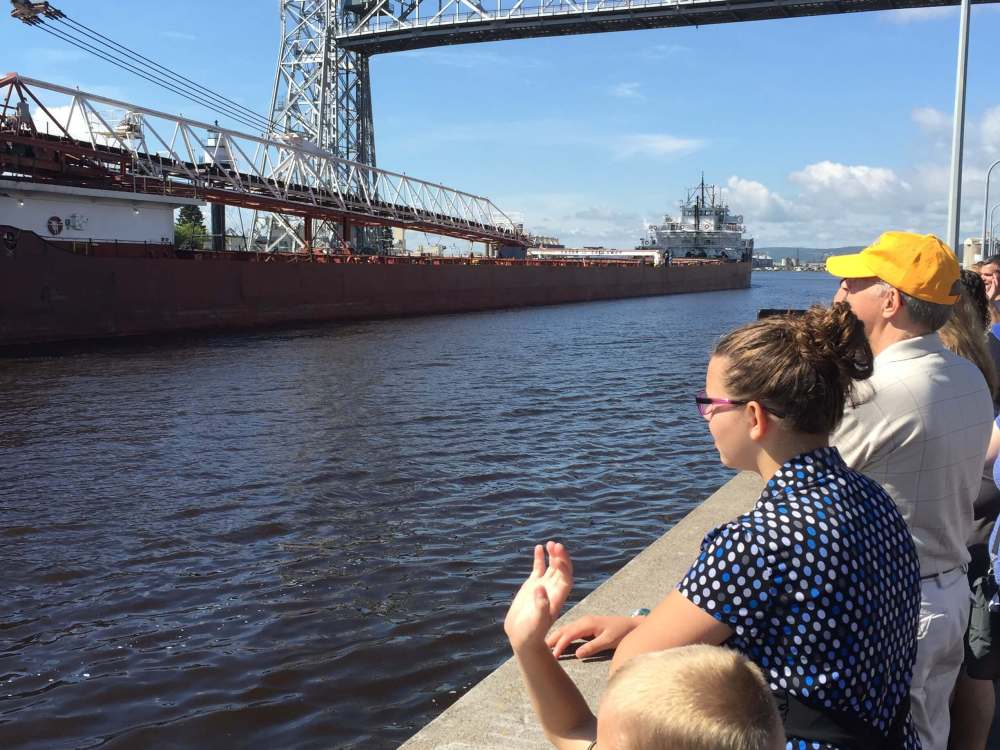 Boys watching Duluth lift bridge