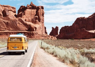 Best travel products featured by top US family travel blog, Travel With a Plan: Yellow van driving alongside mountains