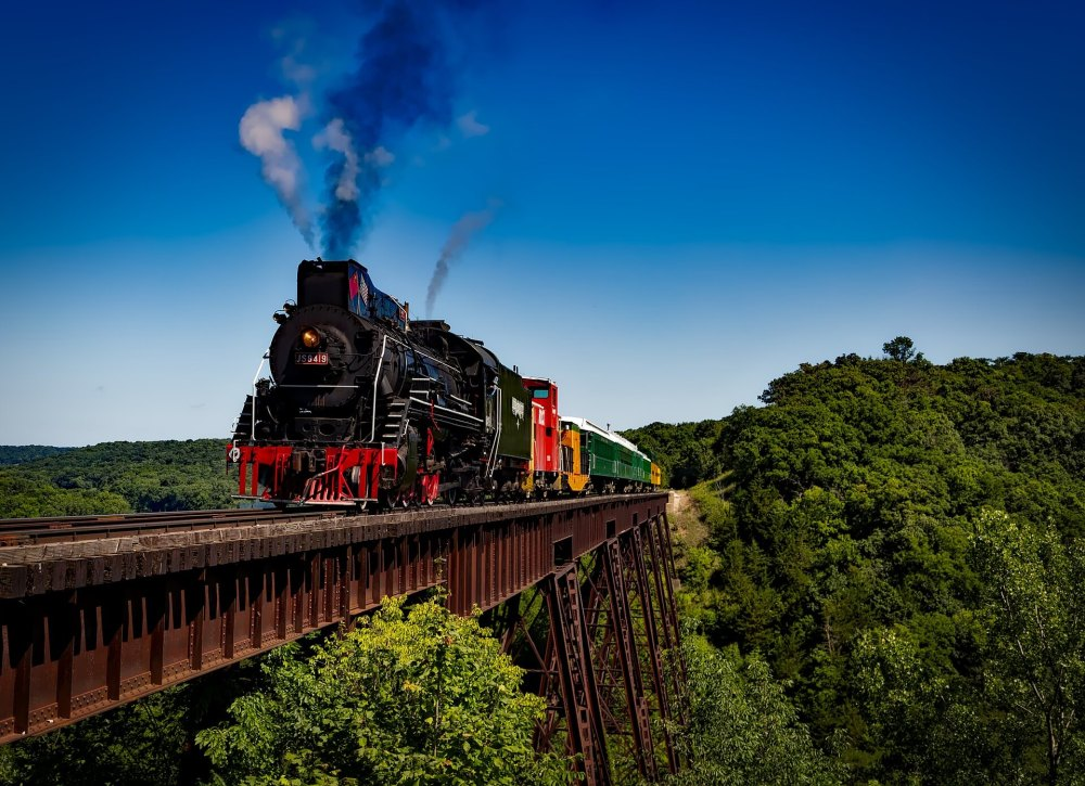 The Best Things to Do in Duluth MN with your Family featured by top US family travel blog, Travel with a Plan: image of North Shore Railroad train blowing steam