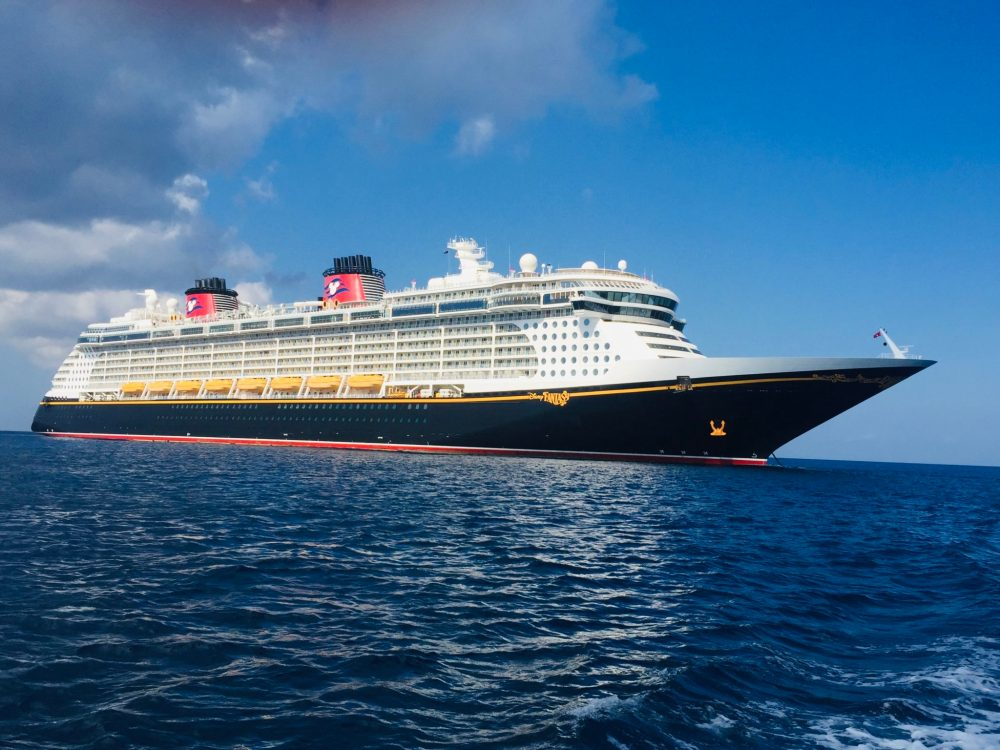 Top U.S. family travel blog Travel With A Plan details what is included in your Disney Cruise fare: Things you should know for your first Disney Cruise!  #DisneyCruiseLine #DisneyCruiseFare #whatisincludedindisneycruise #whatsincludedindisneycruise #whatisnotincludedindisneycruise #whatsnotincludedindisneycruise #priceofadisneycruise #disneycruiseprice #DisneyCruisebudget | Disney Cruise Fare: What's Included and Things You Should Know For Your First Disney Cruise by popular family travel blog, Travel with a Plan: image of a Disney Cruise ship.