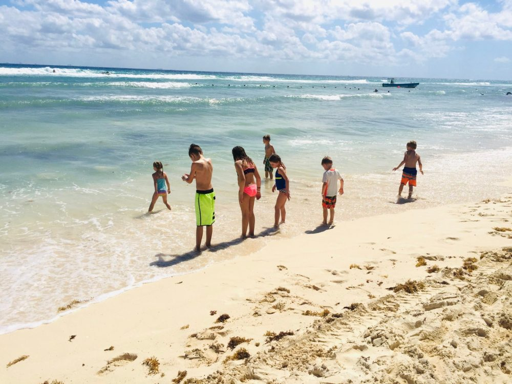 Children by the ocean at Ocean Riviera Paradise