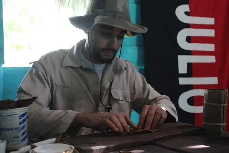 Farmer rolling a cigar