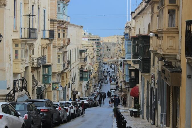 Honey colored buildings and traditional balconies in Valletta, Malta