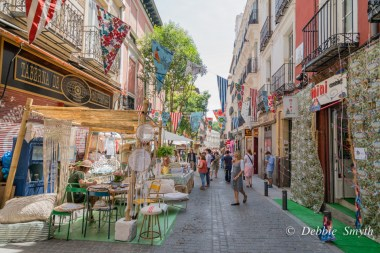 Many stalls sell interior wares in decorated streets