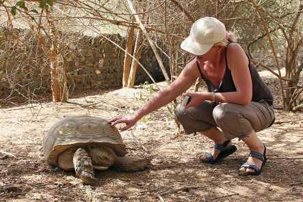 Louise and an giant tortoise, Bandia Wildlife Reserve, Senegal