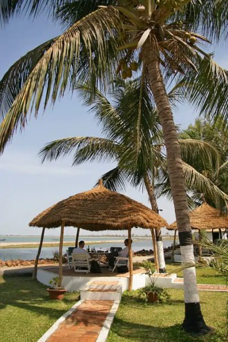 Dine by the water under a thatched cabana at Calypso Beach Bar