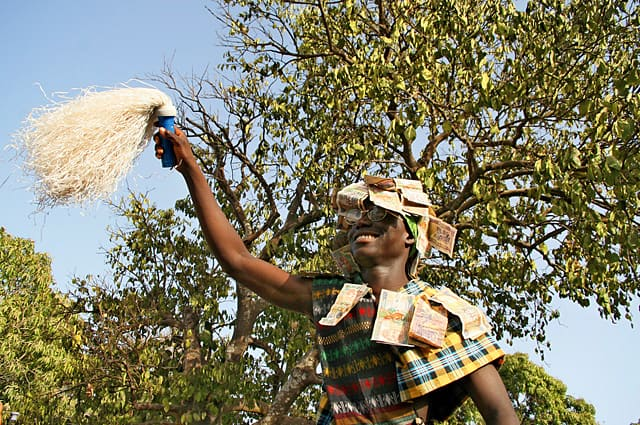 Initiate going into the bush at a Jola initiation festival