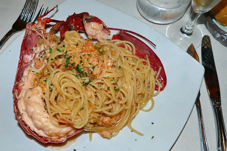 Spaghetti all'astice con pomodorini (Spaghetti with lobster and tomato), at Poste Vecie San Polo, the oldest restaurant in Venice, Italy