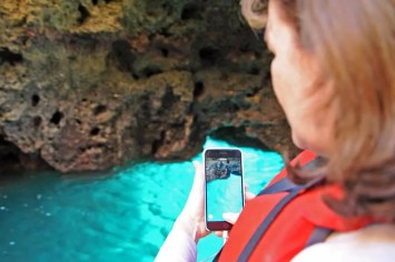 Heather capturing the fabulous colours and light in a grotto at Ponta da Piedade