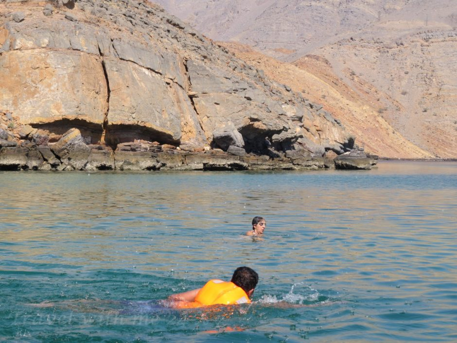 snorkeling in blue waters of oman
