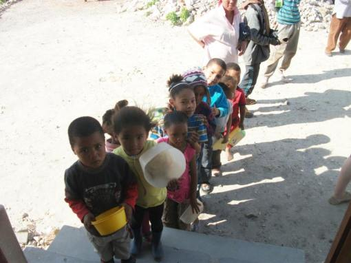 Children waiting in line for food