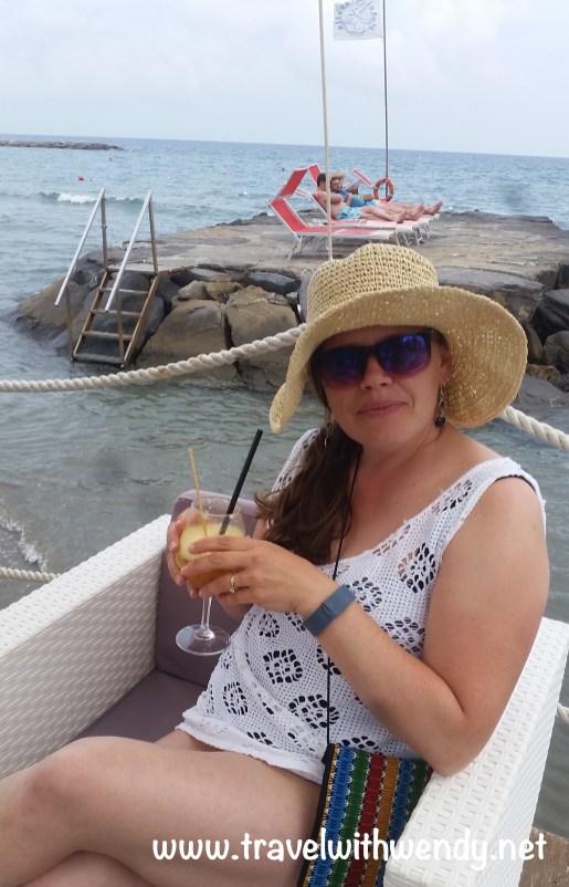 TWW- enjoying drinks seaside