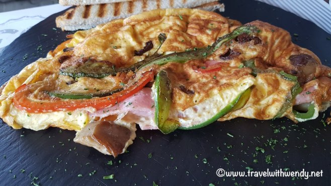 Full omelette with peppers, ham, eggplant
