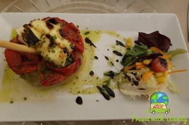 Eggplant, tomatoes and salad