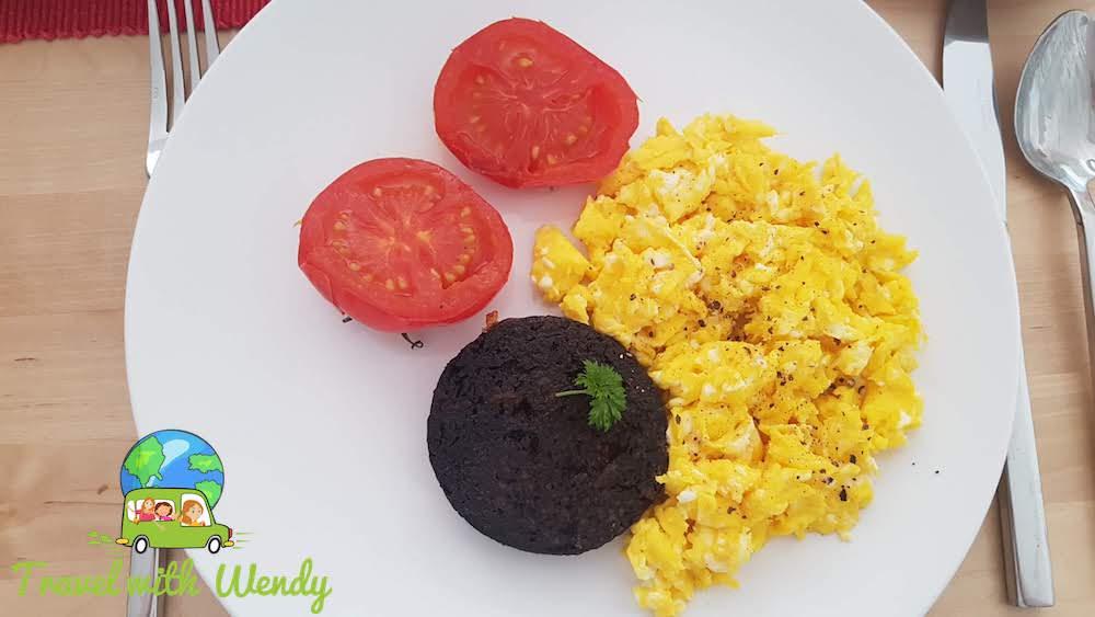 Scrambled eggs and black pudding