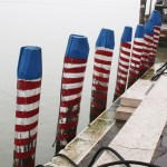 Burano-Italy-Canal-Posts-Red-White-Blue-TravelXena