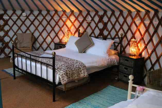 double bed inside a yurt