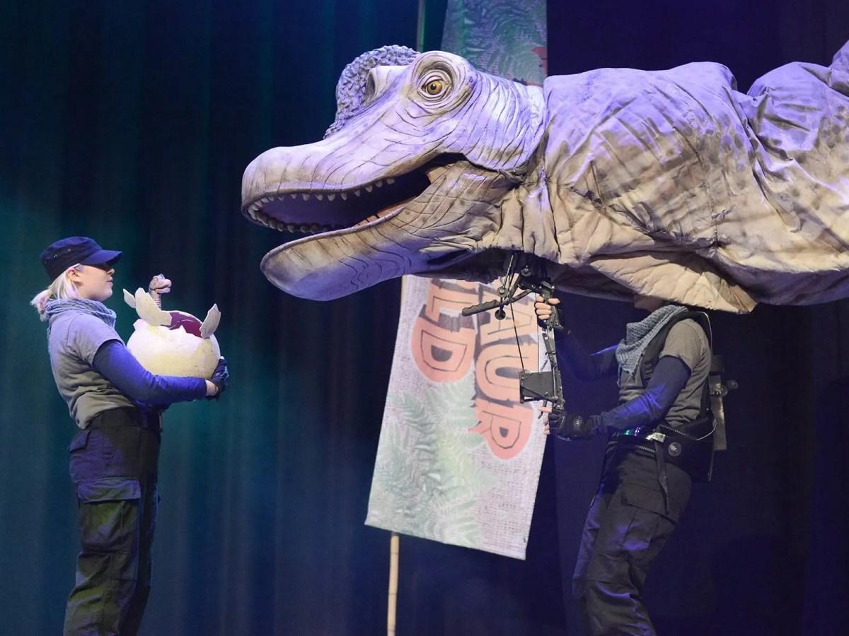 dinosaur puppet in theatre