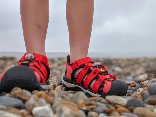 kids sandals on pebble beach