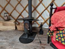 log burner in yurt