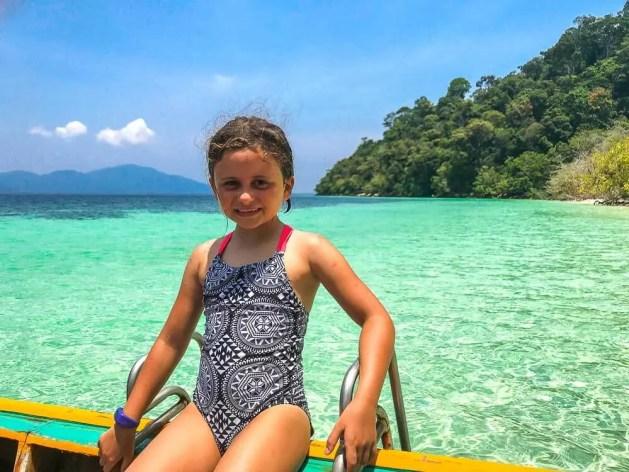 Child ready to swim in sea
