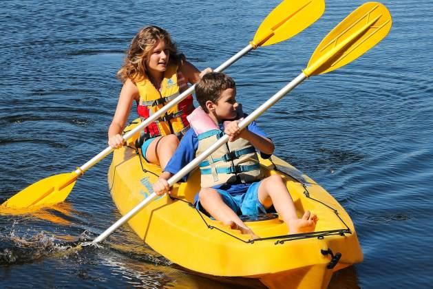 girl and boy on yellow kayak