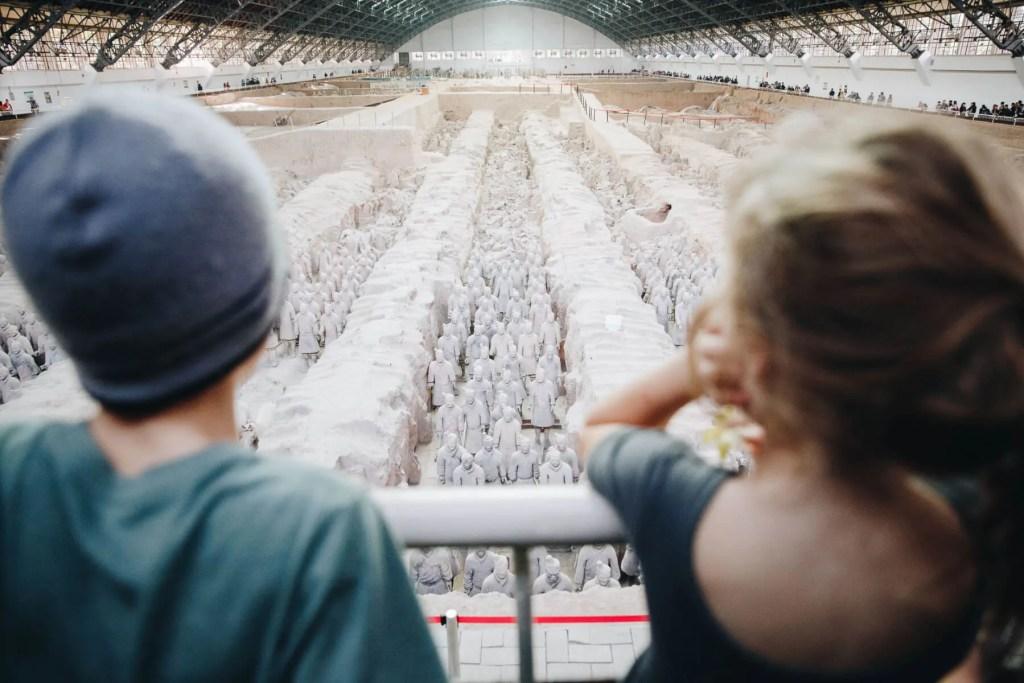 children looking over Terracotta Warriors