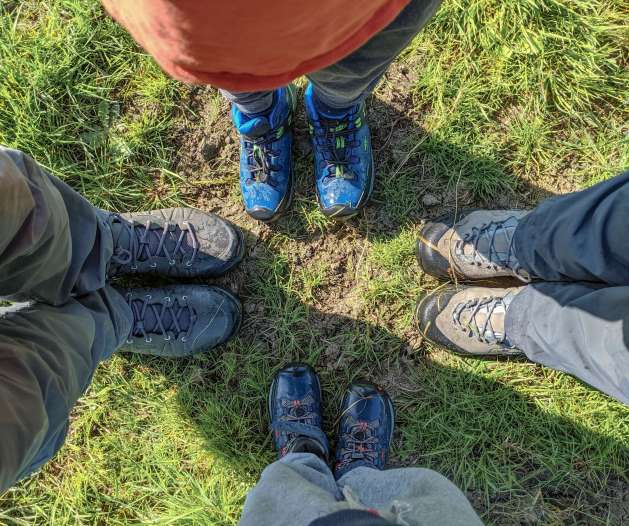 family wearing Keen hiking boots
