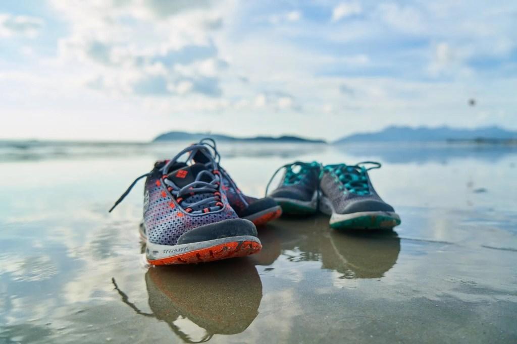 running trainers on beach