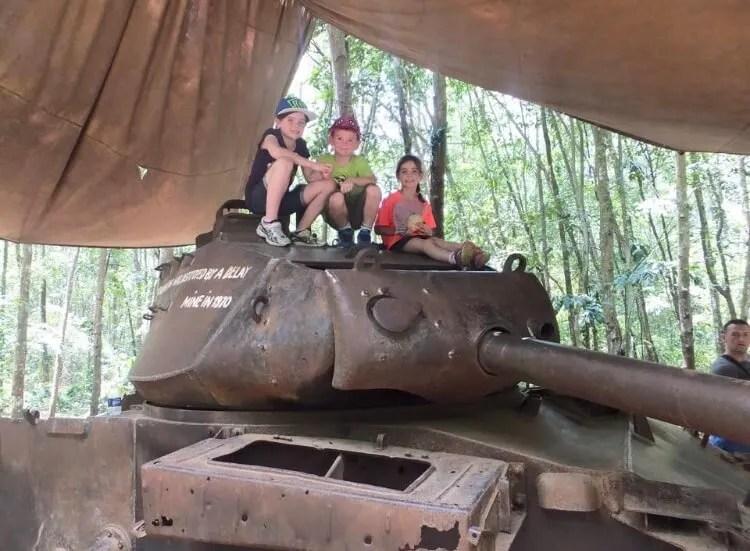 kids on a tank at Cu Chi Tunnels
