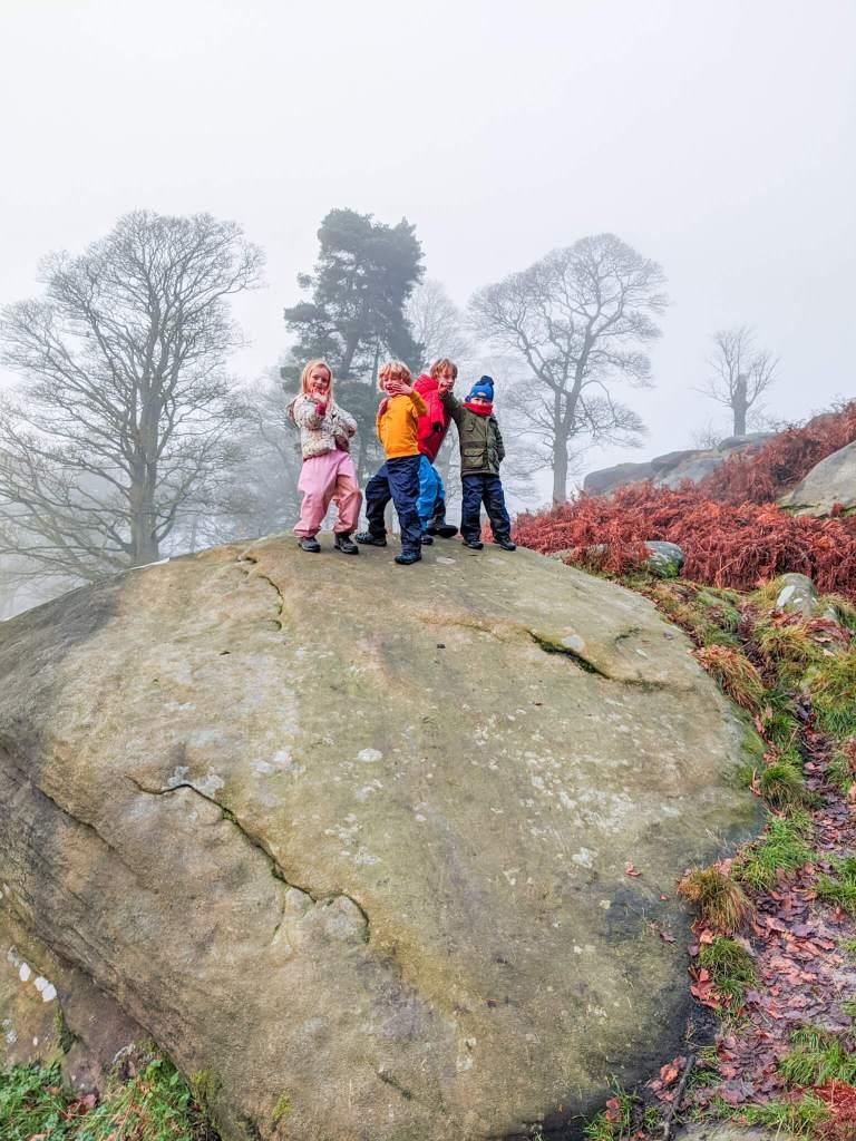 kids on top of boulder in Peak District