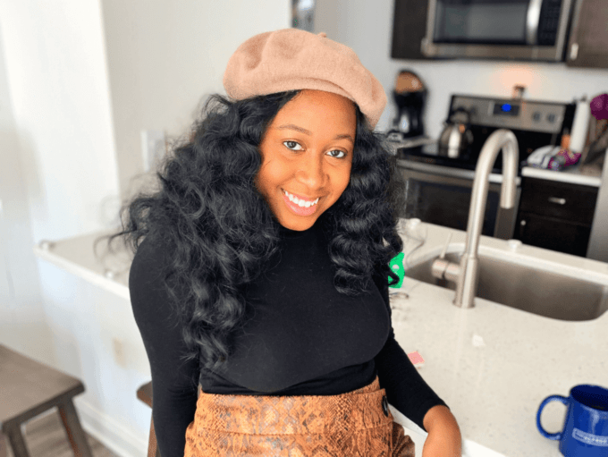 Ermida Koduah, founder of Being Black In posing in a kitchen