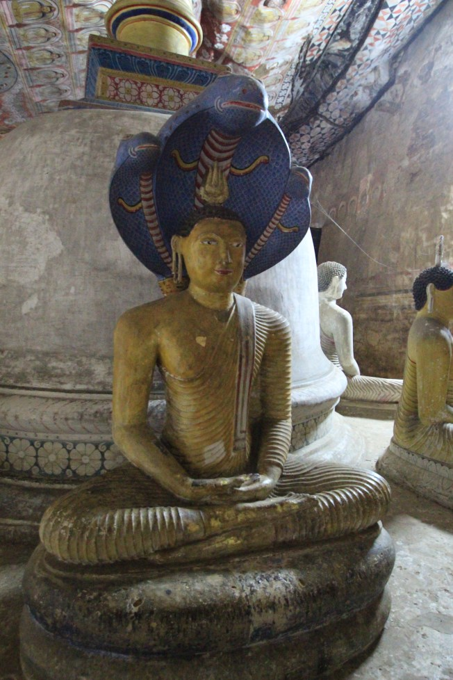 Buddha statue with a cobra headpiece inside the Cave of the Kings