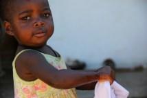 Fatima washing clothes like her Mama
