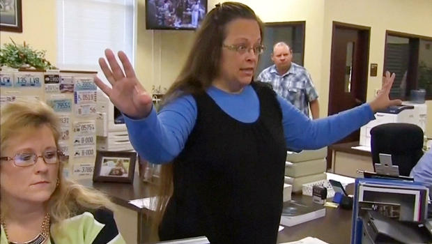 """Rowan County Clerk Kim Davis gestures as she refuses to issue marriage licenses to a same-sex couple in Morehead, Kentucky September 1, 2015, in a still image from video provided by WLEX. Davis, defying a new U.S. Supreme Court decision and citing """"God's authority,"""" rejected requests for marriage licenses from same-sex couples on Tuesday in a deepening legal standoff now two months old. REUTERS/WLEX/LEX18.com FOR EDITORIAL USE ONLY. NOT FOR SALE FOR MARKETING OR ADVERTISING CAMPAIGNS"""