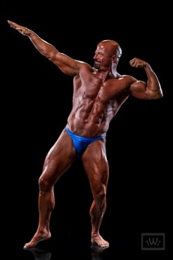 "Bodybuilder Doing ""The Arnold"" Pose"