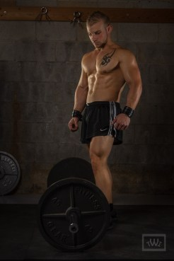 Physique Athlete Standing Over The Bar