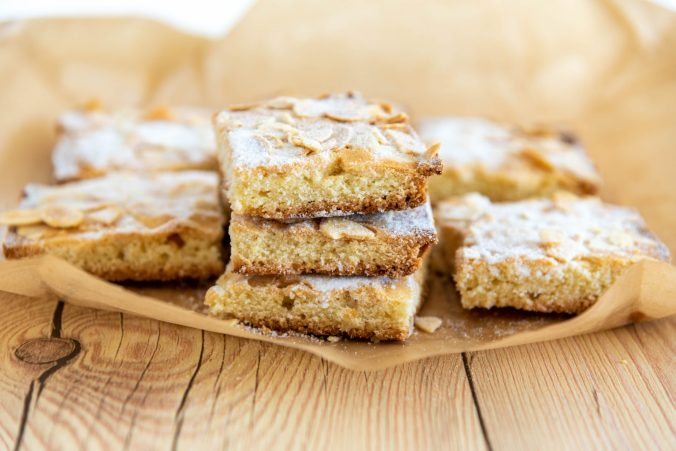 Sugary, almond shortbread sitting on parchment paper