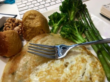 Scallion pancake covered with eggs, homemade bun, broccoli, asparagus and a touch of Taiwanese rice crispy