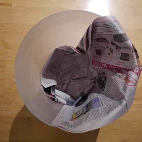 Lining a Bin with Newspaper