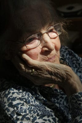 Refection of an older woman
