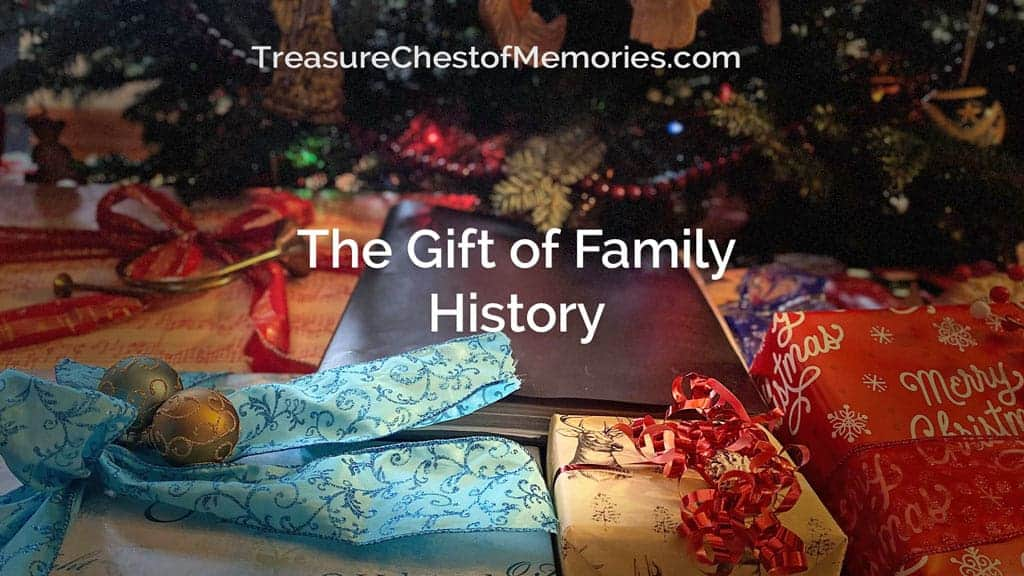 The Gift of Family History graphic with gifts and a binder under the tree