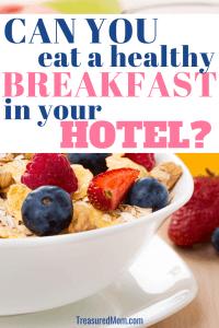 healthy hotel breakfast with orange juice, fruit, oatmeal, berries, coffee, muffin
